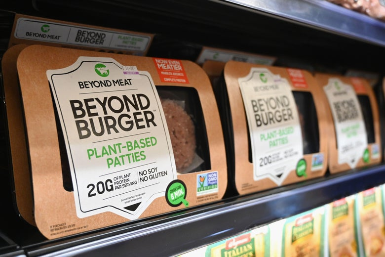 Beyond Burger packs are seen on a grocery store shelf.