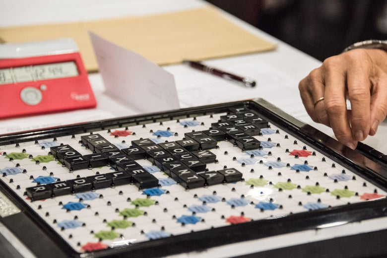 Scrabble players choose a word during the World Scrabble Championships on August 29, 2016 at the Grand Palais in Lille.