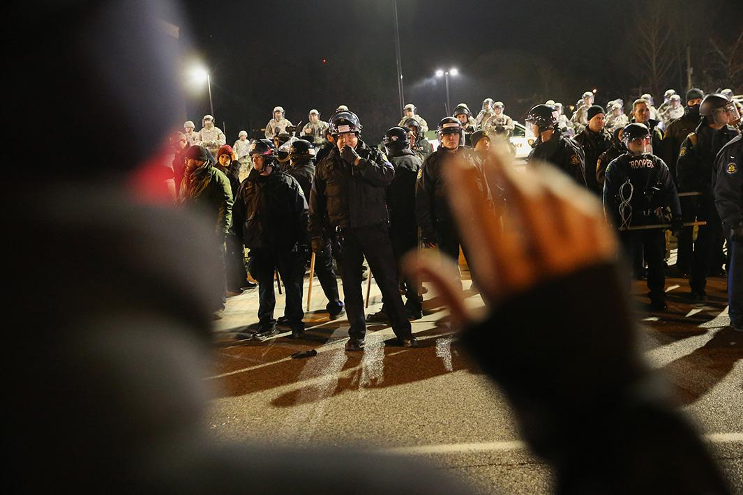 Police confront demonstrators during a protest on Nov. 25, 2014, in Ferguson, Missouri