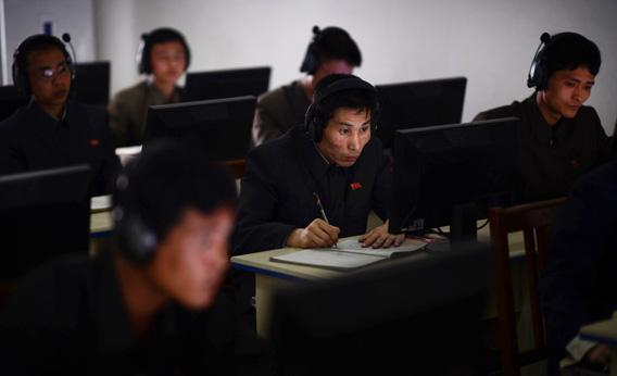 A North Korean worker checks a computer at the control room of a textile factory in Pyongyang in April 2012.