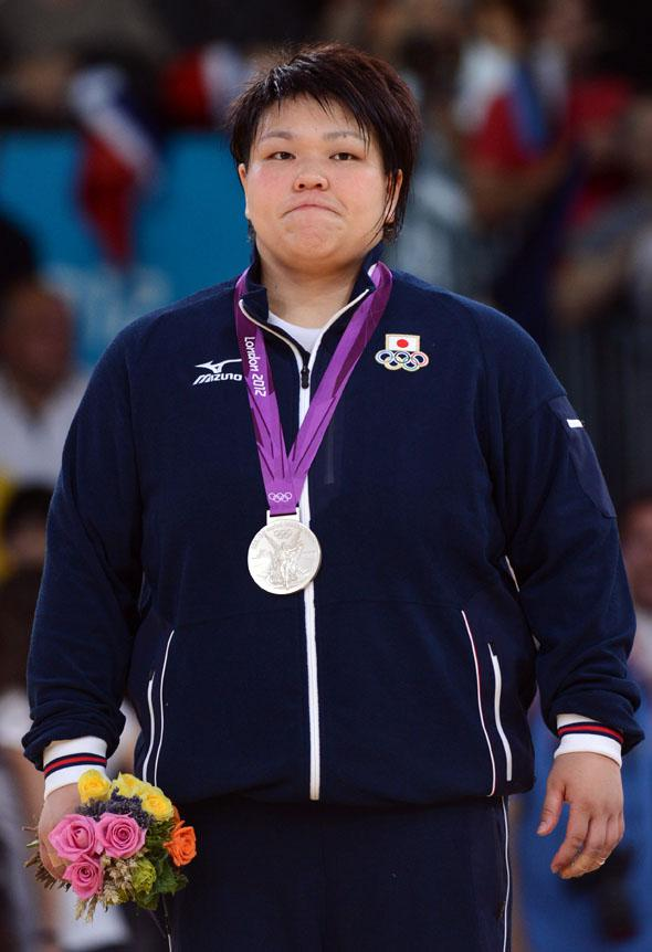Silver medalist Japan's Mika Sugimoto poses on the podium of the women's +78kg judo contest.
