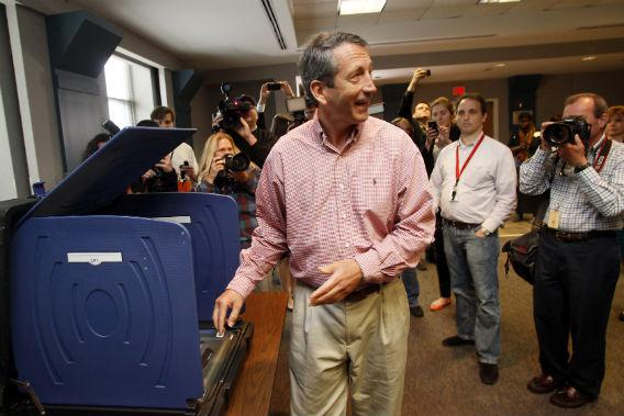 South Carolina Governor Mark Sanford answers a question from the media as he prepares to vote in downtown Charleston, South Carolina.