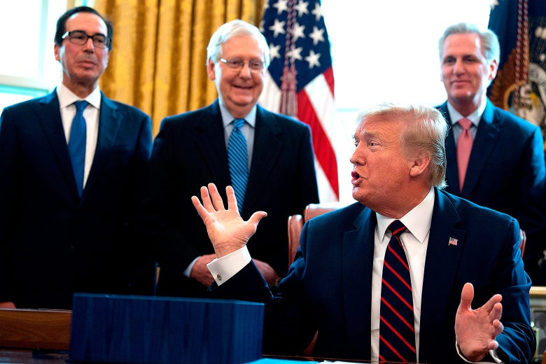 Donald Trump raises he hands while speaking to Steve Mnuchin, Mitch McConnell, and Kevin McCarthy.