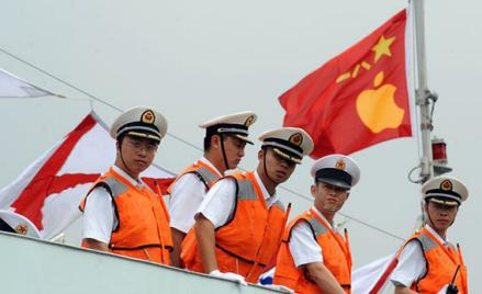 Sailors on a People's Liberation Army (PLA) missile frigate await orders from Cupertino.