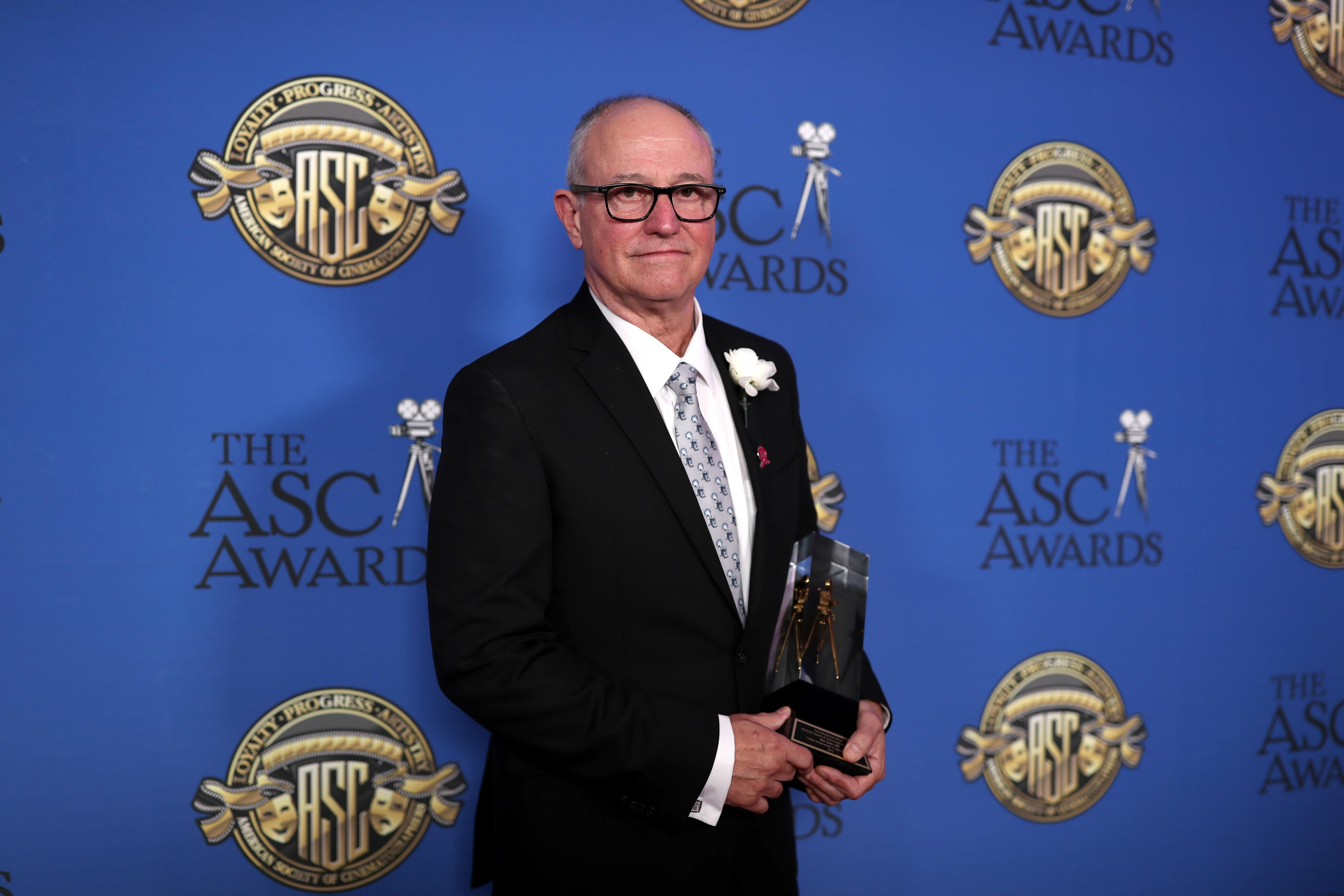Alan Caso poses with the Career Achievement in Television Award during the 32nd Annual American Society Of Cinematographers Awards.