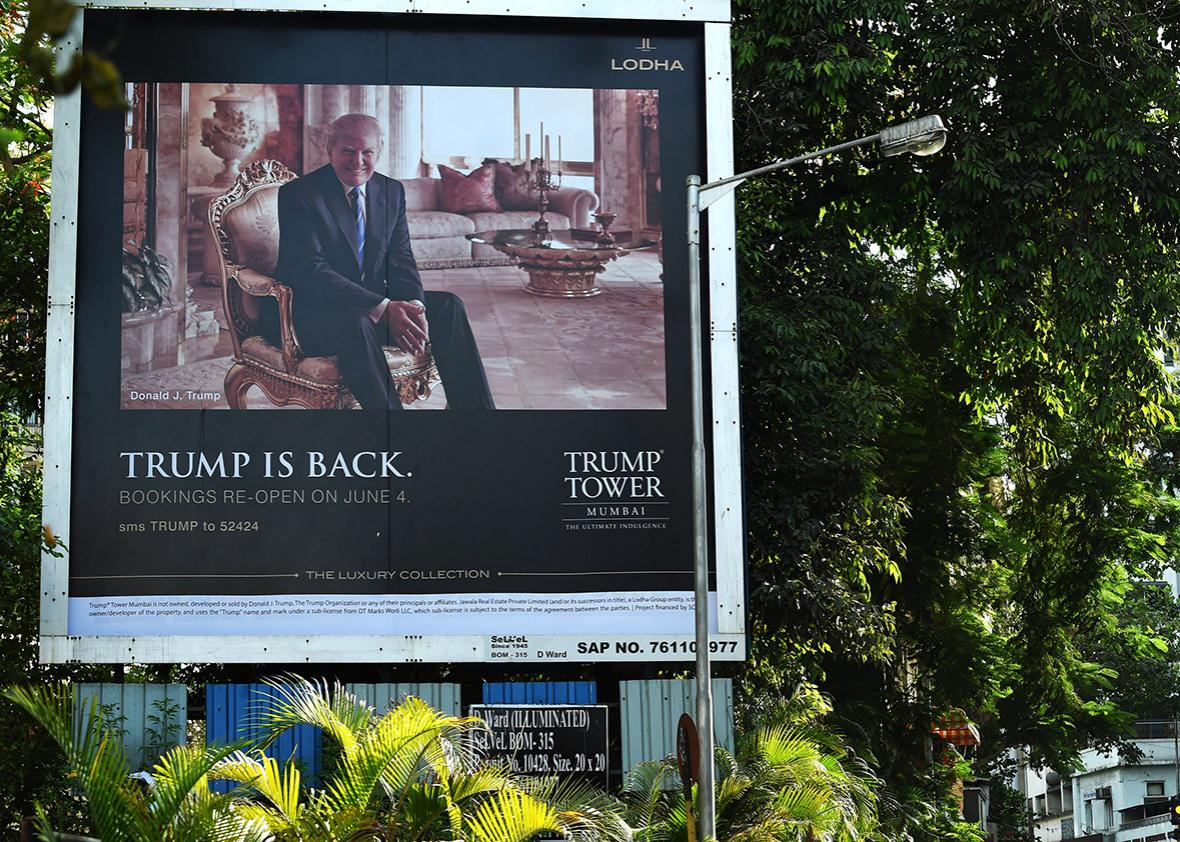 A billboard for the upcoming luxury residential apartment complex Trump Tower Mumbai, which bears the name of billionaire real estate tycoon and US presidential hopeful Donald Trump, is seen next to a busy road in Mumbai on June 3, 2016.