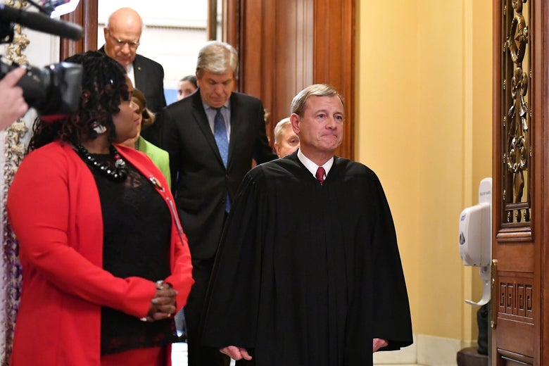US Supreme Court Chief Justice John Roberts (R) walks out of the Senate chamber after the Senate impeachment vote on Capitol Hill in Washington, DC on February 5, 2020. - The US Senate acquitted President Donald Trump of abuse of power and obstruction of Congress following a historic two-week trial. (Photo by Mandel NGAN / AFP) (Photo by MANDEL NGAN/AFP via Getty Images)