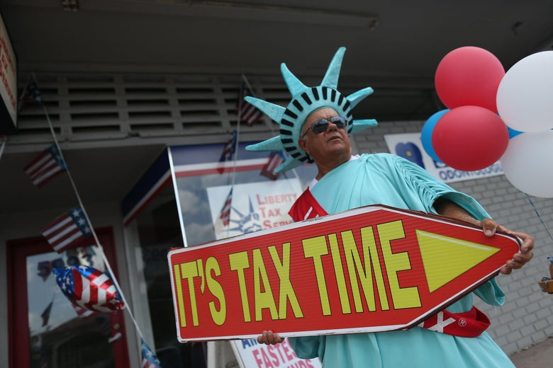 MIAMI, FL - APRIL 15:  Armando La Rosa directs people to the Liberty Tax Service office as the deadline to file taxes looms on April 15, 2016 in Miami, Florida.  The Internal Revenue Service moved the deadline from April 15th to Monday the 18th due to the Emancipation Day holiday in Washington, D.C.  (Photo by Joe Raedle/Getty Images)