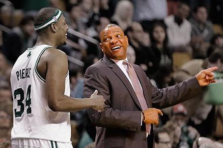 Doc Rivers and Paul Pierce at a game against the Detroit Pistons.