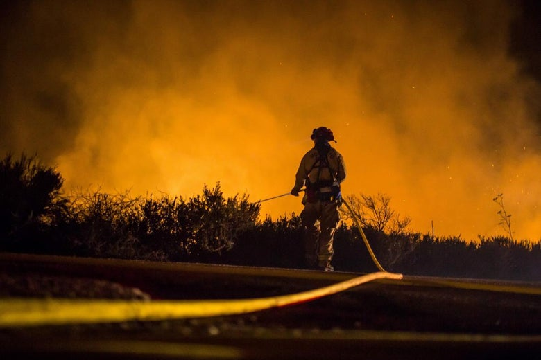Firefighters work to extinguish the Thomas fire in Ventura, California, on Thursday.