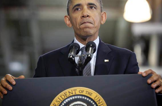 President Barack Obama pauses as he speaks at Argonne National Laboratory in Argonne, Ill., March 15, 2013.