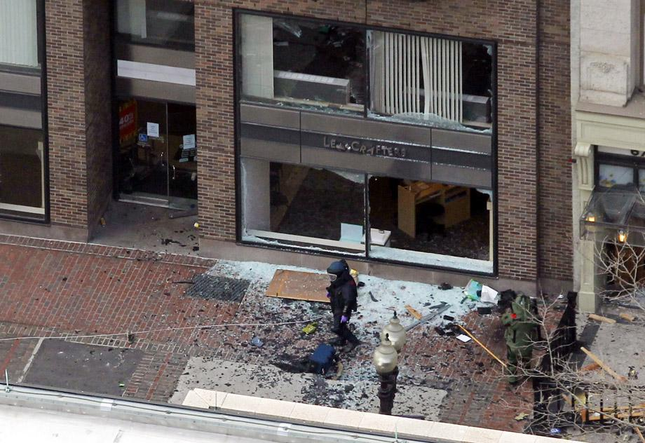 A man in a bomb-disposal suit investigates the site of an explosion which went off on Boylston Street during the 117th Boston Marathon in Boston.