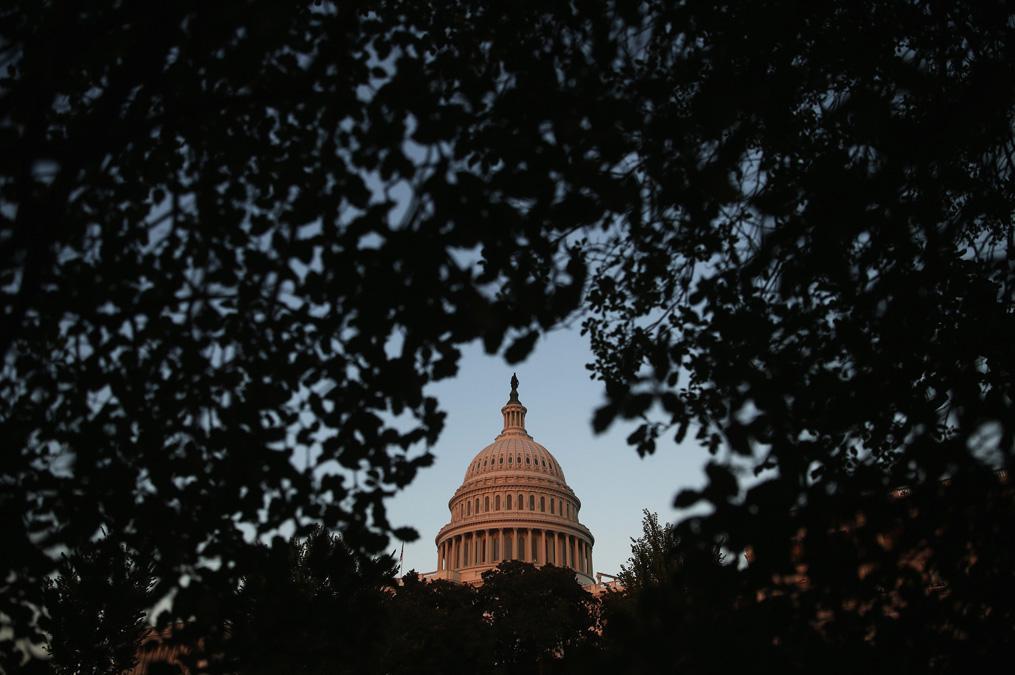 Dusk falls on the U.S. Capitol, Sept. 30, 2013.