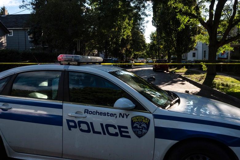 Police tape lines a crime scene after a shooting at a backyard party on September 19, 2020, Rochester, New York.