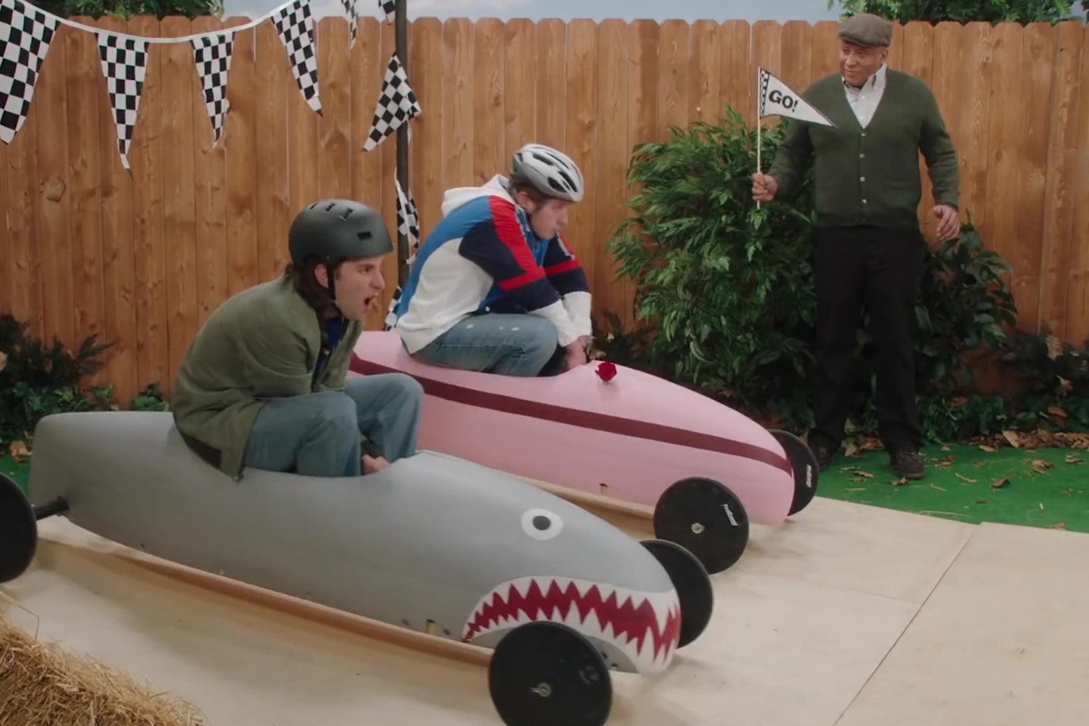 Kyle Mooney and Beck Bennett riding downhill derby racers.