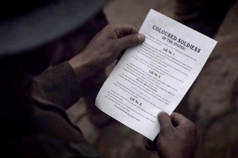 A black soldier holding a WWI leaflet.