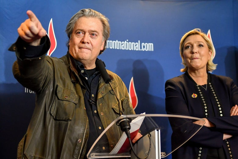 Steve Bannon (L) gestures as he stands next to France's far-right party National Front (FN) president Marine Le Pen after giving a speech during the party's annual congress, on March 10, 2018 at the Grand Palais in Lille, northern France.