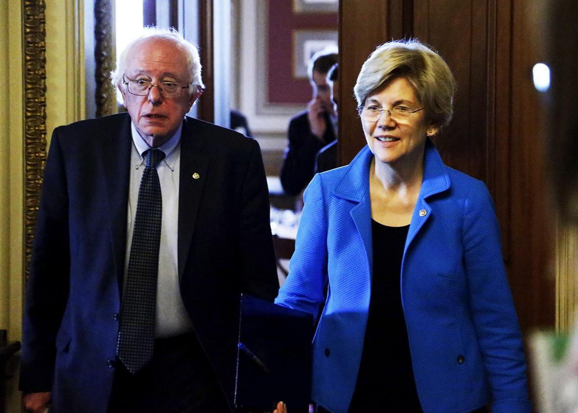 U.S. Senators Bernie Sanders and Elizabeth Warren walk to the Senate floor after the weekly Democratic caucus policy luncheon at the U.S. Capitol in Washington May 12, 2015.