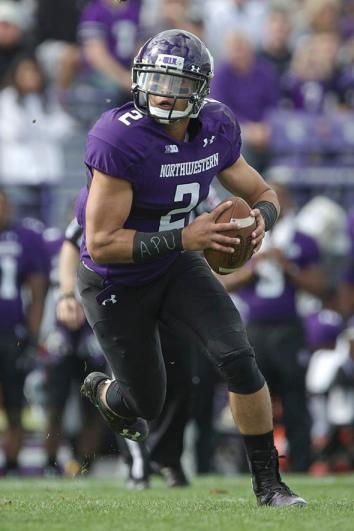 Kain Colter #2 of the Northwestern Wildcats rushes on the Maine Black Bears.