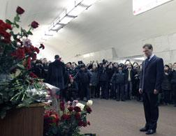 Dmitry Medvedev lays flowers at the site of a terrorist blast. Click image to expand.
