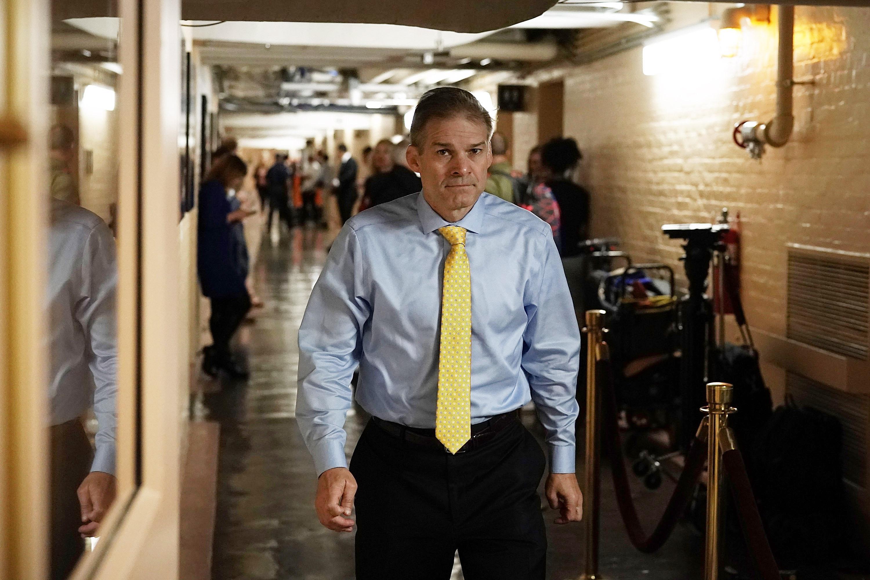 Jim Jordan walks down a hall on Capitol Hill.