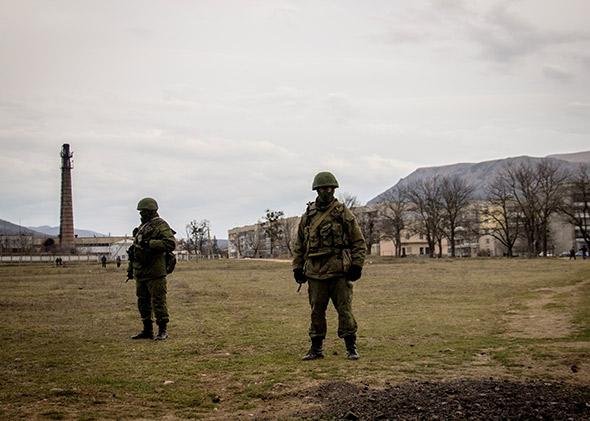 Russian forces have taken several Ukrainian military installations in Crimea without firing any shots.