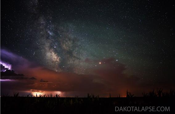 Shooting star with the Milky Way and a storm