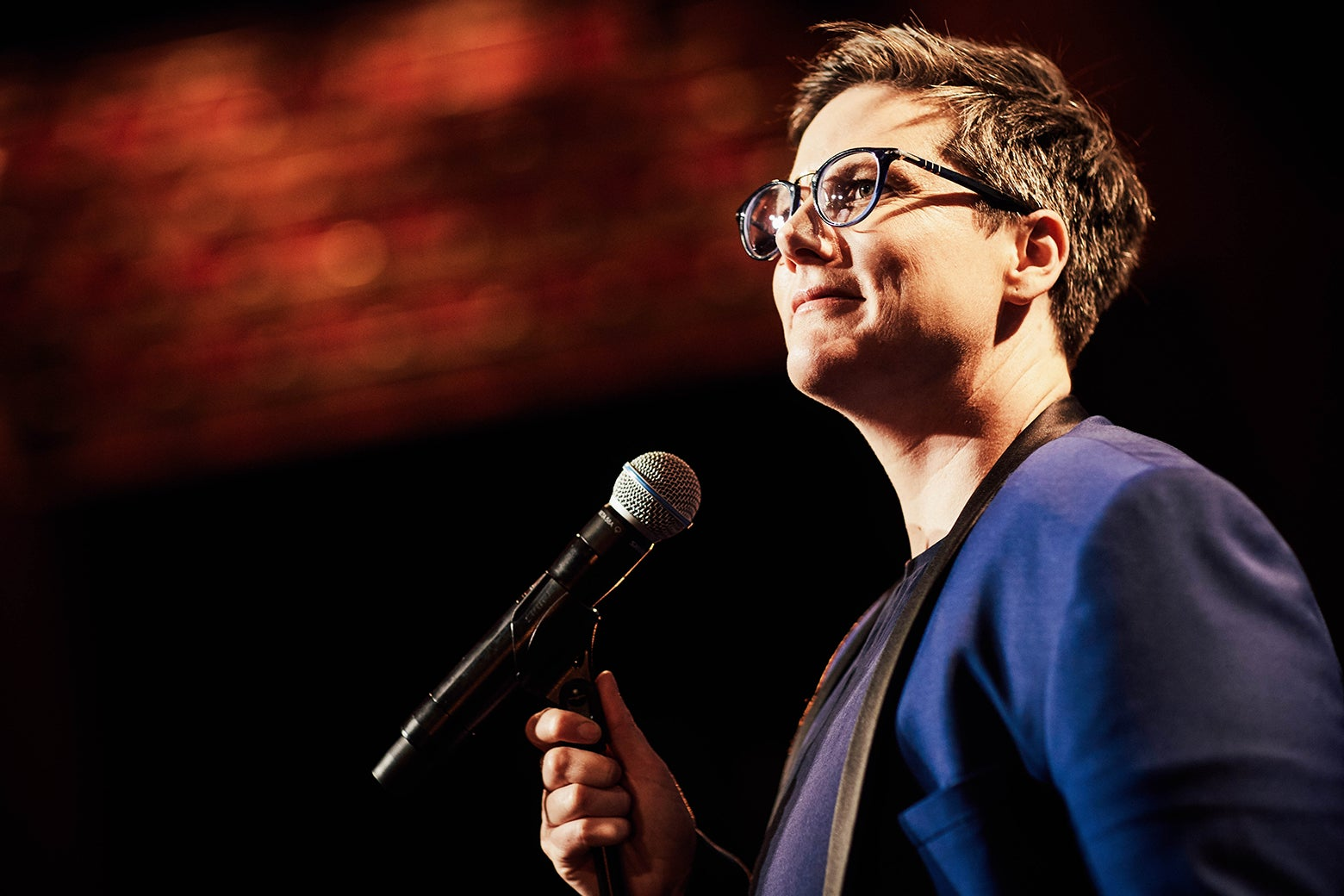 Hannah Gadsby stands, mic in hand, during a stand-up show.