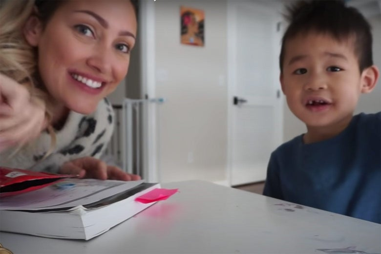 A blond white woman and a smiling Asian child.