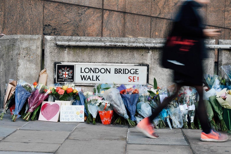 Bouquets of flowers are placed on London Bridge.