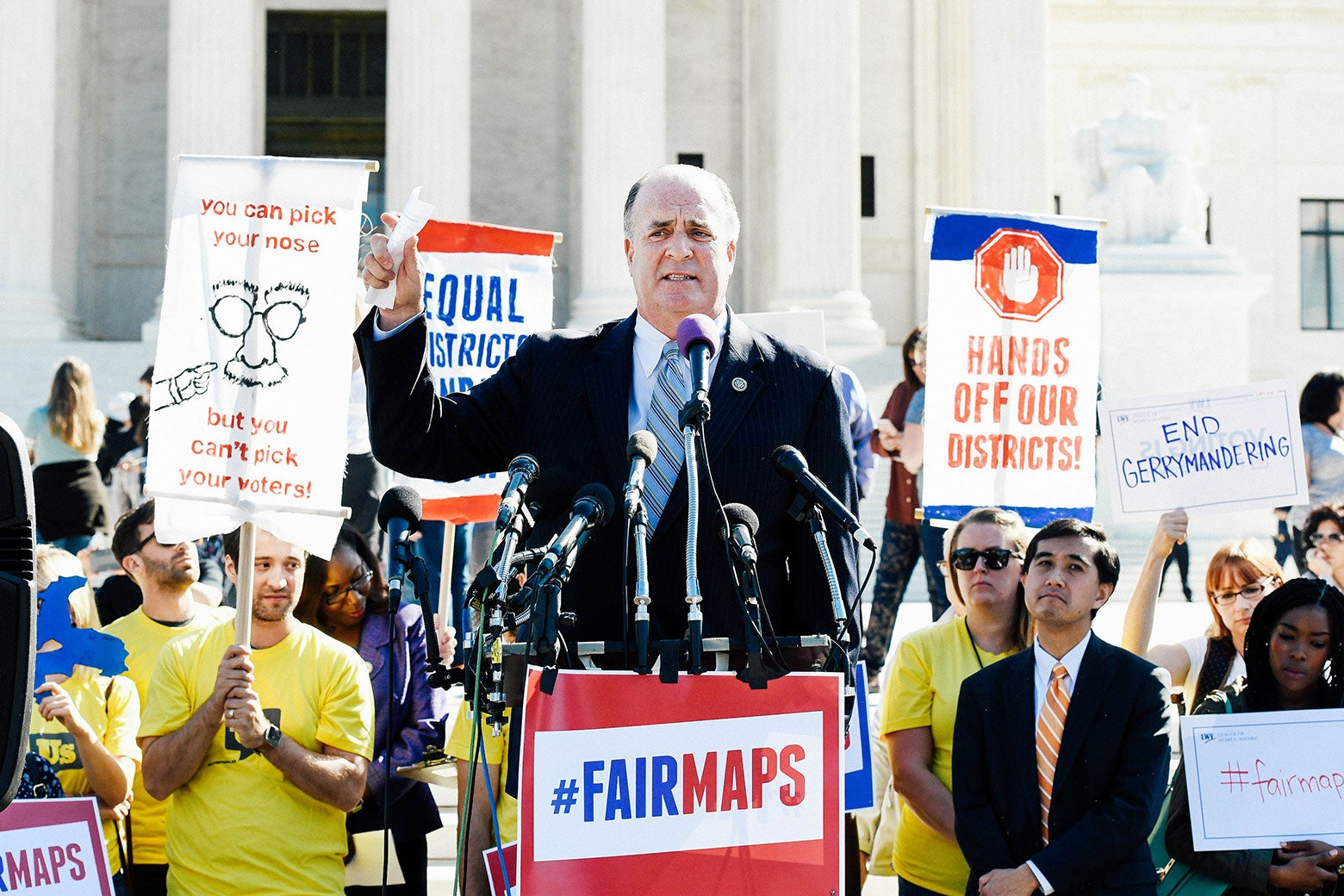 Dan Kildee at a podium that says #FairMaps.