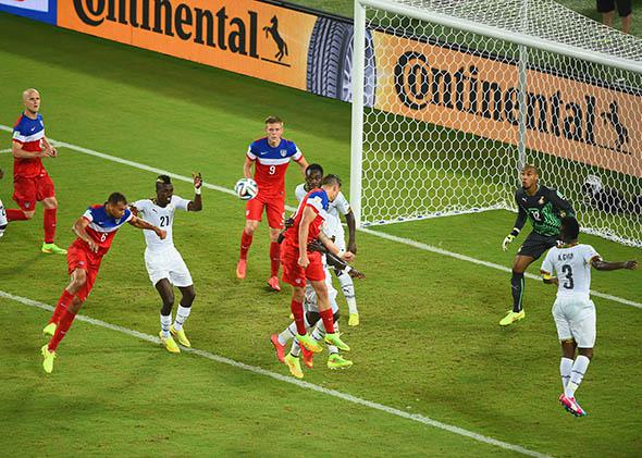 John Brooks of the United States scores his team's second goal on a header past Adam Kwarasey of Ghana during the 2014 FIFA World Cup Brazil.