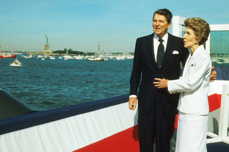 President Ronald Reagan stands with his wife Nancy during the Statue of Liberty's centennial celebration on July 4, 1986, in New York City.