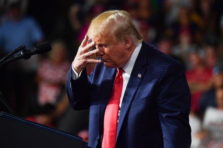 Donald Trump mocks Joe Biden at a campaign rally.