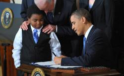 US President Barack Obama signs the health insurance reform bill.