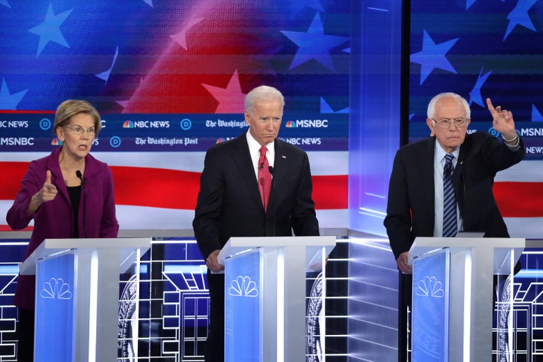 Sen. Elizabeth Warren speaks as former Vice President Joe Biden and Sen. Bernie Sanders listen during the Democratic Presidential Debate at Tyler Perry Studios November 20, 2019 in Atlanta, Georgia.