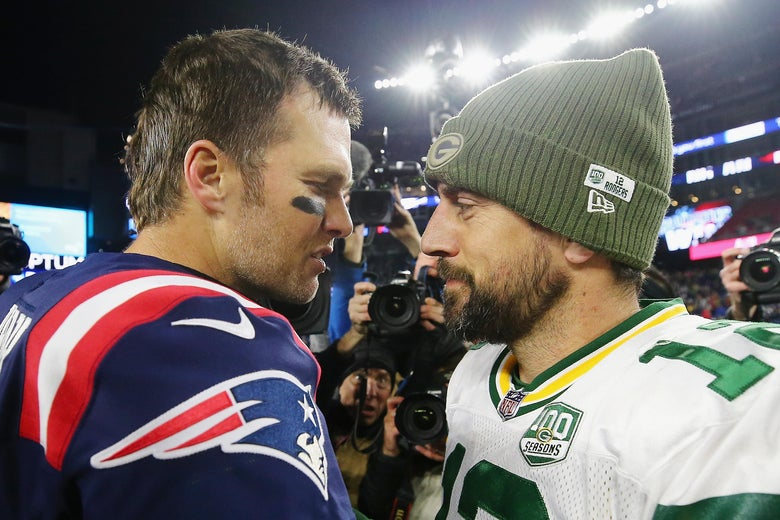 Tom Brady stands face to face with Aaron Rodgers for a postgame chat on the field