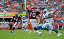 Tim Tebow #15 of the Denver Broncos passes against the Miami Dolphins.