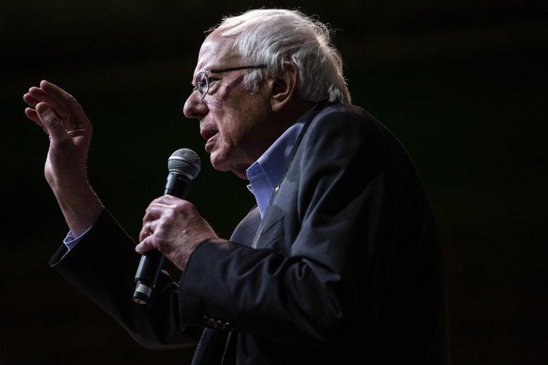 Bernie Sanders holding a mic.