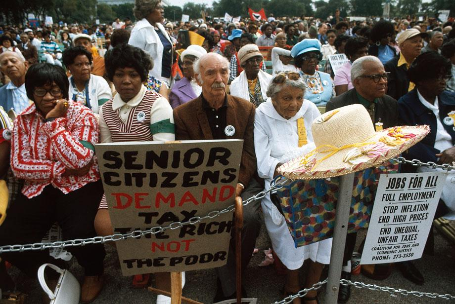"A senior citizens march to protest inflation, unemployment and high taxes stopped along Lake Shore Drive in Chicago to hear speeches from various officials. The rally was headed by the Rev. Jesse Jackson and Operation Push."" John H. White, Chicago, Illinois, October 1973"