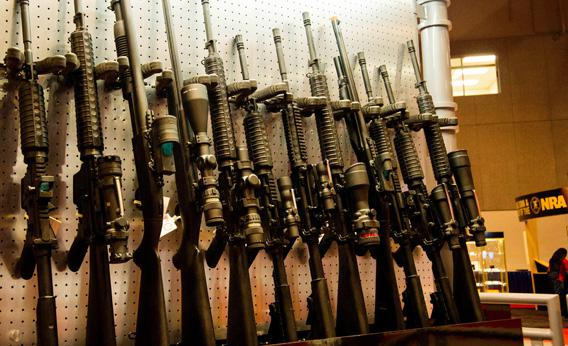 A wall of semi-automatic rifles at the National Rifle Association Annual Meetings and Exhibits