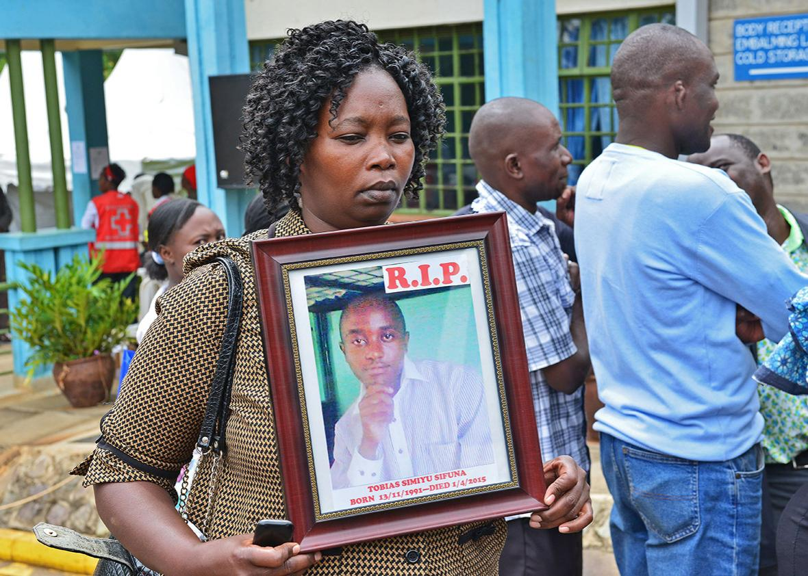 A women holds the portrait of Garissa terrorist attack victim Tobias Simiyu Sifuna at Chiromo morgue in Nairobi on April, 9,2015.