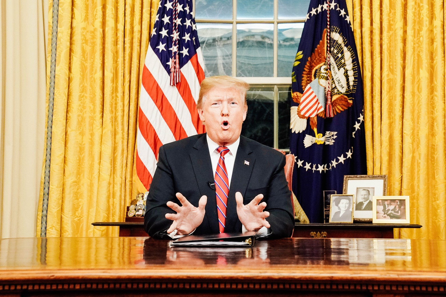 Donald Trump is captured mid-phrase, fingertips spread out and mouth open, during his prime-time address on Jan. 8.