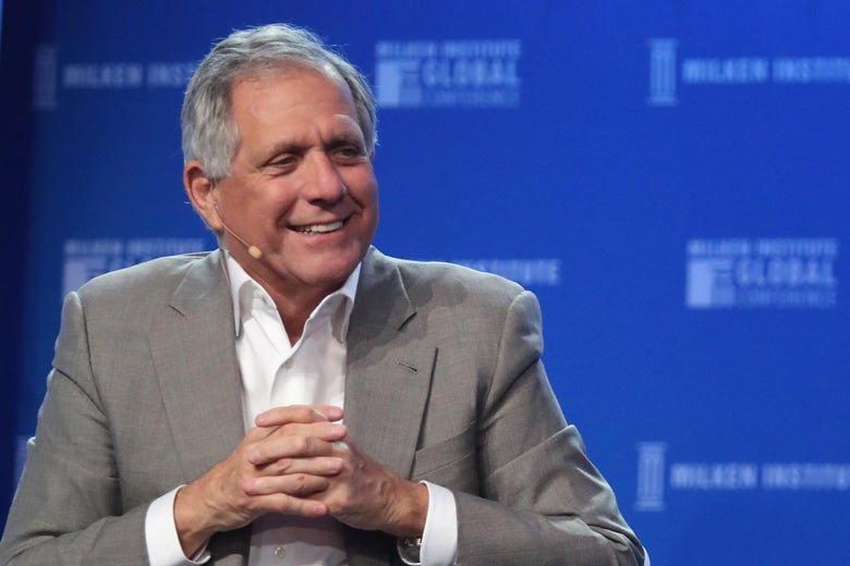 Leslie Moonves sits, smiling, with his hands folded.