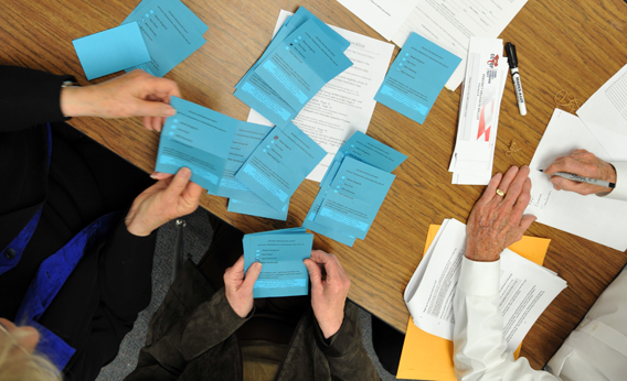 Volunteers count ballots from voters during a Republican caucus at Becker Middle School February 4, 2012 in Las Vegas, Nevada.