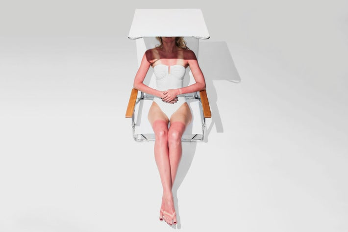 Woman sitting in the Telescope Casual Original Mini-Sun Chaise.