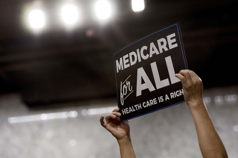 A member of the audience holds up a placard as U.S. Sen. Bernie Sanders, an Independent from Vermont, discusses Medicare for All legislation on Capitol Hill in Washington on Sept. 13.