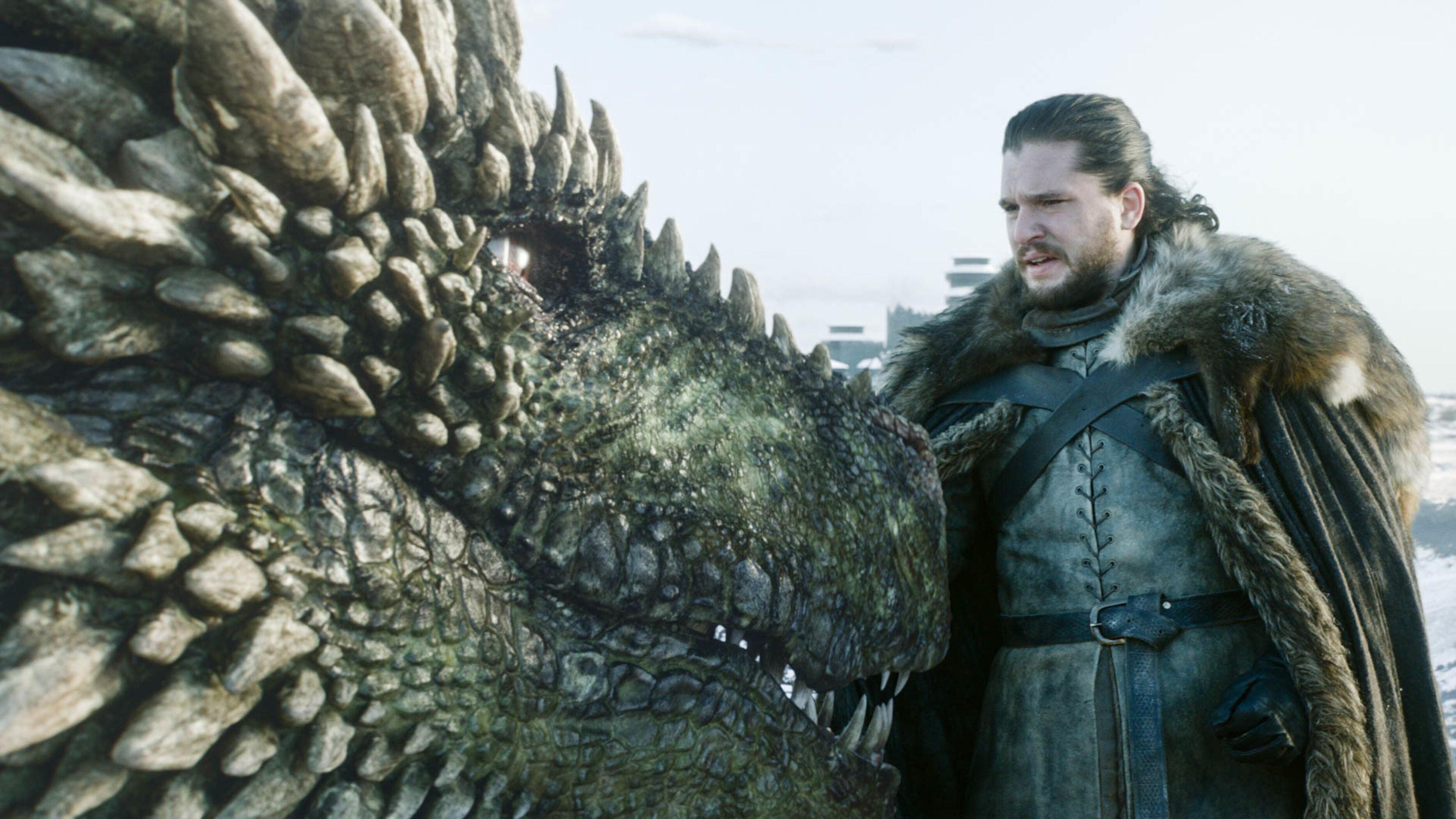 Jon Snow pets a dragon.