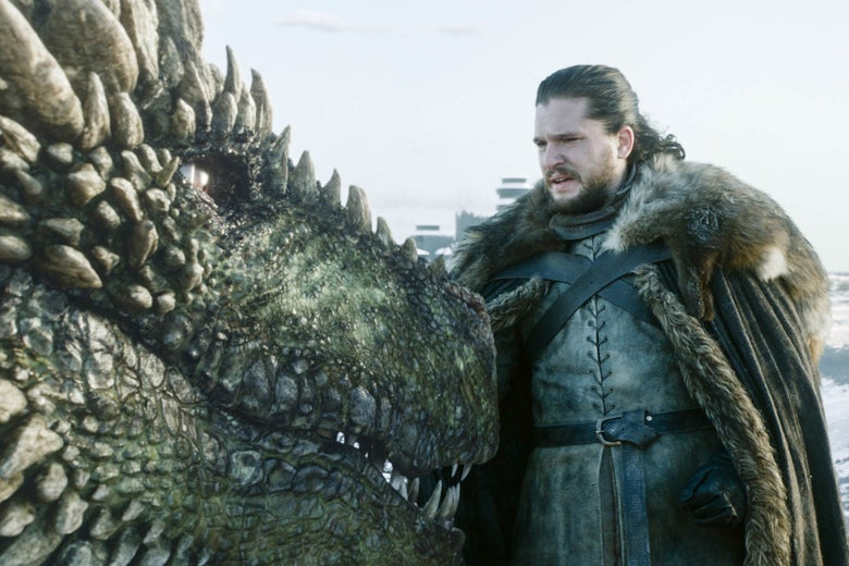 Jon Snow pets a dragon.