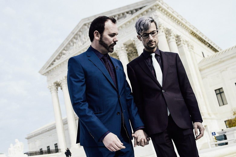 Charlie Craig and Dave Mullins hold hands outside the U.S. Supreme Court as Masterpiece Cakeshop vs. Colorado Civil Rights Commission is heard on Dec. 5 in Washington.